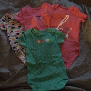 4 onesies from carters